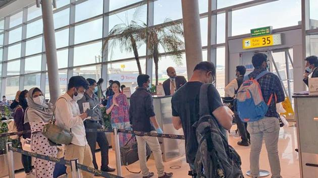 Passengers at the boarding gate of Abu Dhabi Airport ready to board Abu Dhabi to Kochi special flight IX452 under Vande Bharat Mission, in Abu Dhabi on Thursday.(ANI Photo)