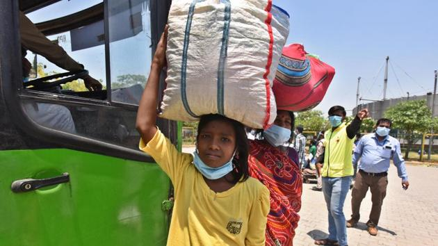 Migrant workers, dismissed by employers, enjoying no protection from their governments, often thrown out of their accommodation by their landlords, in urgent need of food transport and money, have been driven by desperation to walk home.(Raj K Raj/HT PHOTO)