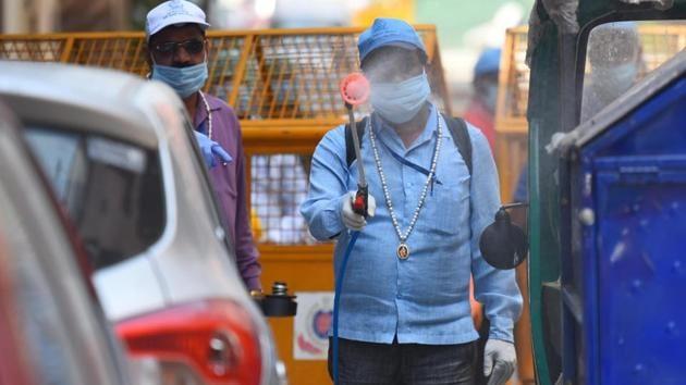 East Delhi Municipal Corporation (EDMC) workers on sanitization drive of a containment zone in Pandav Nagar, New Delhi on Friday.(Raj K Raj/HT PHOTO)