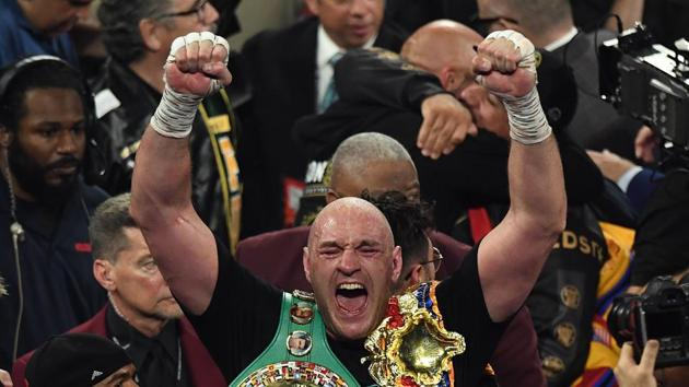 (FILES) In this file photo taken on February 22, 2020 British boxer Tyson Fury celebrates after defeating US boxer Deontay Wilder.(AFP)