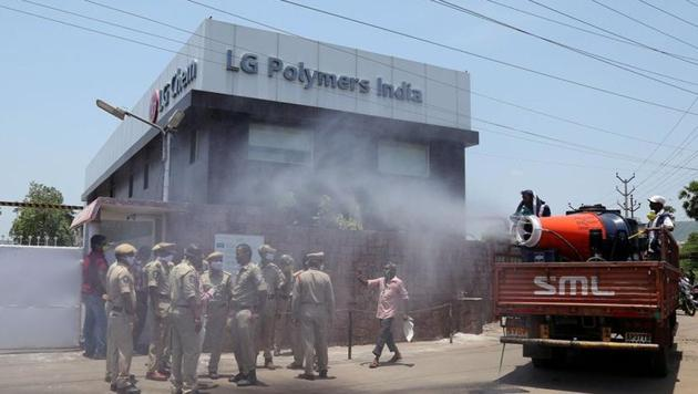Municipal workers decontaminate outside of the LG Polymers Plant following a gas leak at the plant in Visakhapatnam.(Reuters Photo)