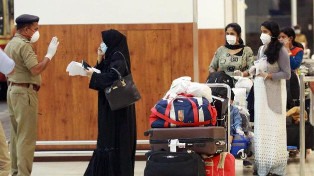 Stranded passangers being screened as they check out from the Kochi International Airport as they arrive from Abu Dhabi by special Air India Express flight in Kochi on Friday.(ANI Photo)