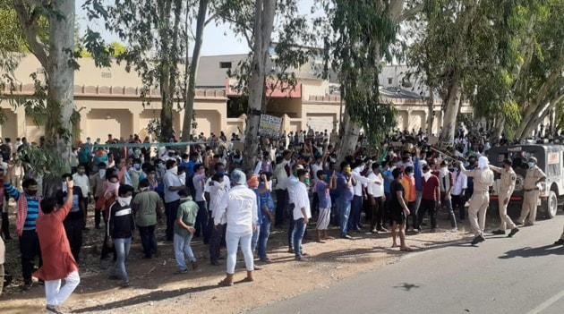 Migrant workers in Bhilwara during a protest on Sunday demanding that authorities arrange for their return home.(HT PHOTO)