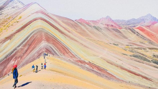 In January, a photo of rainbow-hued mountains showed up on Instagram, was shared on travel pages, and prompted users to report it as fake.(Unsplash)