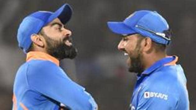 Indian captain Virat Kohli celebrates with Rohit Sharma and Ravindra Jadeja.(PTI)