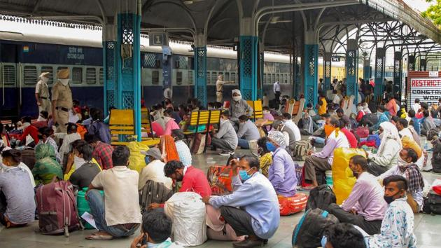 Migrants sit on a platform while waiting to board 'Shramik Special' train for Ayodhya at a railway station, during the ongoing Covid-19 , in Patiala, Sunday, May 10, 2020.(PTI)