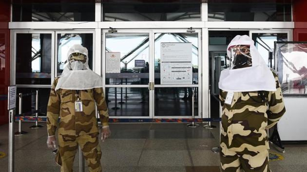 CISF personnel seen wearing protective headgear during lockdown, in Terminal 3 of IGI Airport, New Delhi, India, on Sunday, May 10, 2020.(Vipin Kumar/HT PHOTO)