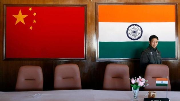 A man walks inside a conference room used for meetings between military commanders of China and India, at the Indian side of the Indo-China border at Bumla, in the northeastern Indian state of Arunachal Pradesh.(REUTERS)