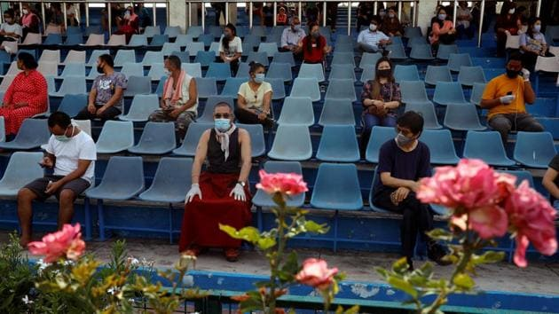 Stranded residents of Ladakh, a union territory in India, wait in a stadium for being thermal screened before taking buses back to Ladakh, after few restrictions were lifted by Delhi government during an extended nationwide lockdown to slow the spread of the coronavirus disease (COVID-19), in New Delhi.(REUTERS)