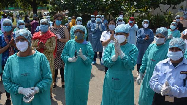 Nurses working under NHM want adequate salaries at par with outsourced and regular nurses, as well as and insurance cover to secure their families in case of any untoward incident in the line of duty during the epidemic.(HT file photo)