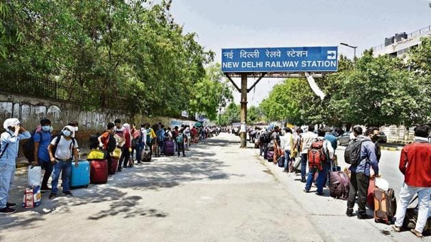 People queue outside the New Delhi Railway Station after train services resumed for the first time since the nationwide lockdown was imposed to curb the spread of coronavirus, in New Delhi.(Photo by Vipin Kumar / Hindustan Times)
