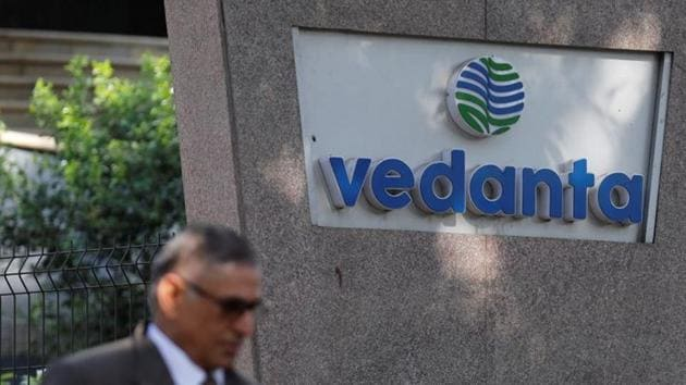 A man walks past the logo of Vedanta outside its headquarters in Mumbai.(REUTERS)