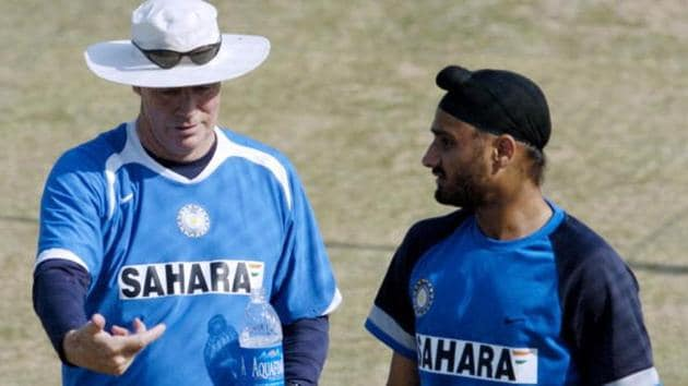 Mohali, INDIA: Indian cricket coach Greg Chappell (L), chats with Indiam cricketer Harbhajan Singh (R)(AFP/Getty Images)
