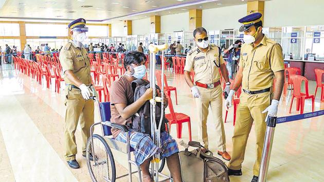 Kerala police personnel led by Inspector General of Police Vijay Sakhare (second from right) assist a differently-abled man after being disembarked by INS Jalashwa carrying repatriated Indian citizens from Maldives, at Cochin Port.(PTI)