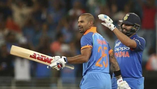 India's captain Rohit Sharma, right, congratulates teammate Shikhar Dhawan on scoring a century during the one day international cricket match of Asia Cup between India and Pakistan in Dubai, United Arab Emirates, Sunday, Sept. 23, 2018. (AP Photo/Aijaz Rahi)(AP)