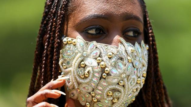 Nigerian fashion stylist Sefiya Diejomoah, 35, poses for a picture with a blinged-out face mask matching with her clothes, following the spread of the coronavirus disease (COVID-19) in Lagos, Nigeria May 14, 2020. Picture taken May 14, 2020. REUTERS/Temilade Adelaja(REUTERS)
