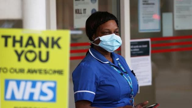 An NHS worker at the Chelsea and Westminster Hospital as part of a campaign in support of the NHS, following the outbreak of the coronavirus disease Covid-19, in London on May 14.(Reuters Photo)