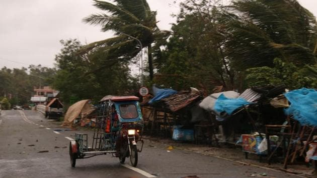 A man drives his tricycle along a road as strong winds caused by Typhoon Vongfong hit the Catbalogan city. Locally called Ambo, the first typhoon to hit the Philippines this year has weakened as it made landfall several times since Thursday afternoon. (Simvale Sayat / AP)