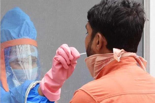 A health worker collects swabs from a man for a coronavirus test, Ranchi, Jharkhand(Diwakar Prasad/ HTPHOTO)