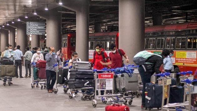 Indian nationals who were stranded in Singapore arrive by Air India flight at Mumbai International Airport after being evacuated by the government under 'Vande Bharat' mission, during the ongoing Covid-19 lockdown, in Mumbai.(PTI)