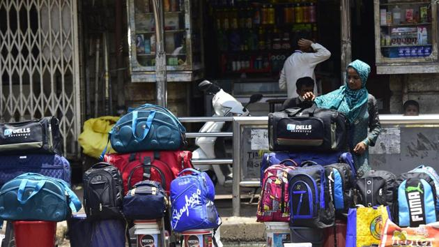 Mumbai, India - May 15, 2020: Hawker sells travelling bags which highly demanded by migrant workers as they seek to return to their homes.(Anshuman Poyrekar/HT Photo)