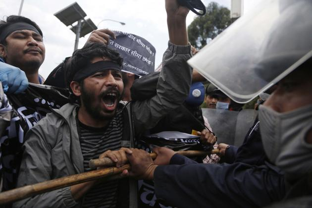 Nepalese students shout slogans as they are detained by policemen during a protest amid lockdown in Kathmandu, Nepal.(PTI)
