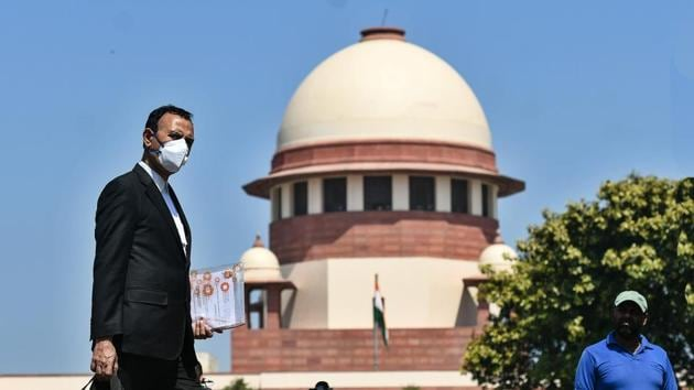 A lawyer covers his face with protective mask to prevent himself from coronavirus at Supreme Court, in New Delhi.(Biplov Bhuyan/HT FILE PHOTO)