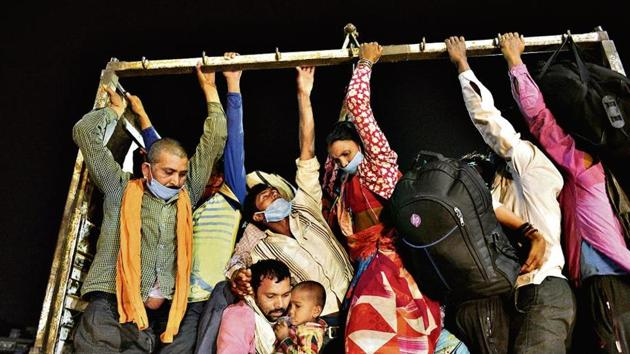 The lockdown since March 25, put in place to slow the spread of the coronavirus disease (Covid-19) has left hundreds of thousands of people without work, wages and, often, food – forcing most of them to set out on gruelling journeys on foot.(Ajay Agarwal/HT Photo)