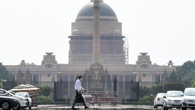 A man walks past the Rashtrapati Bhawan during lockdown, in New Delhi, India.(Arvind Yadav/HT PHOTO)