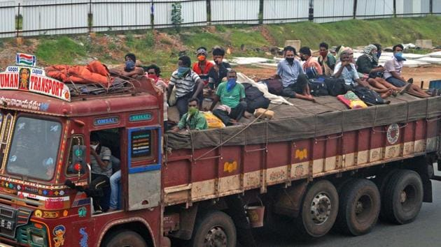 Migrant labourers board a truck at the national highway (NH16) as they try to reach their native place during the Covid-19 lockdown in Bhubaneswar on Tuesday.(ANI File Photo)
