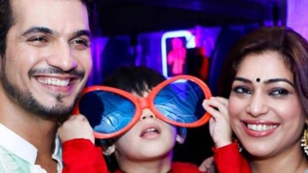 Arjun Bijlani with wife Neha Swami and their son.