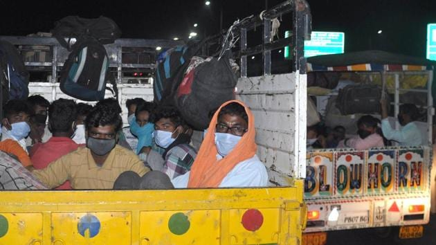 Stranded migrant workers seen in a mini truck while on a journey back home to another state amid the lockdown, near Shambhu, Punjab, India, on Tuesday, May 19, 2020.(Photo by Bharat Bhushan/Hindustan Times)