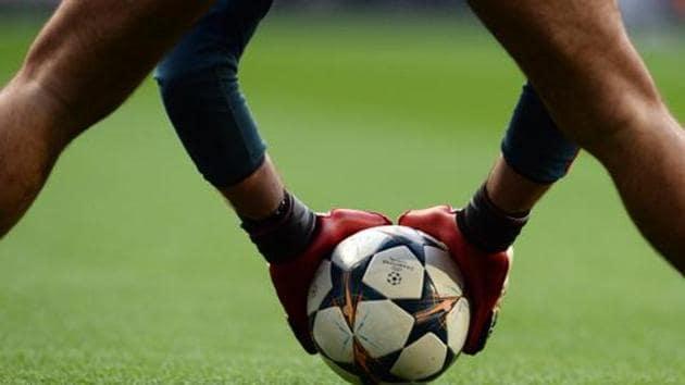 A Bayern Munich goalkeeping coach holds a Champions League football(AFP)