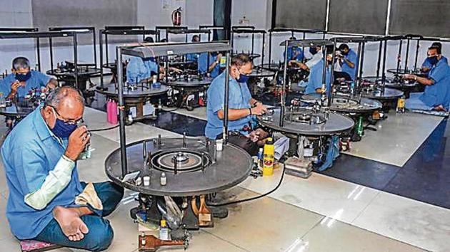 Workers at a diamond unit in Surat on Wednesday.(PTI file photo)