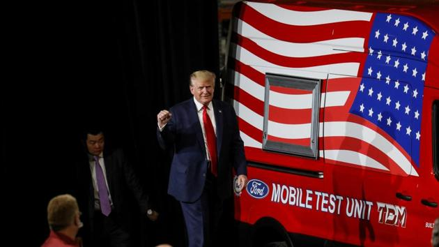 US President Donald Trump walks past a mobile test vehicle as he arrives to speak during a visit at the Ford Rawsonville Components Plant, which is making ventilators and medical supplies, during the coronavirus disease pandemic in Ypsilanti, Michigan.(REUTERS)
