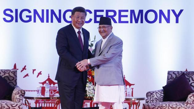 Chinese President Xi Jinping, left, and Nepalese Prime Minister Khadga Prasad Oli greet during their bilateral meeting in Kathmandu, Nepal in October 2019.(AP File Photo)