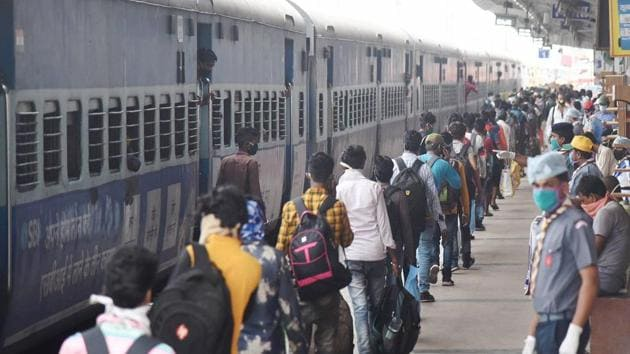 Migrants, maintaining social distancing, stand in a queue after deboarding 'Shramik Special' train at Danapur railway station near Patna.(PTI Photo)