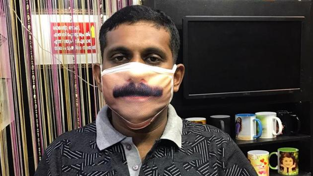 A digital photographer in Etumanoor in Kottayam, Binesh G Paul (38), has developed a unique mask to overcome this identity crisis.(HT PHOTO.)