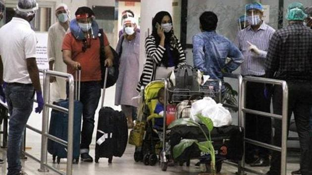 Uttar Pradesh, May 22 (ANI): Indian Nationals stranded in Malaysia arrives at Chaudhary Charan Singh Airport by a special flight in the late night, in Lucknow on Thursday. (ANI Photo)(ANI PHOTO.)