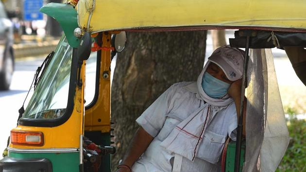 An auto-rickshaw driver takes a cat nap with his face covered while waiting for passengers at KG Marg, New Delhi, on May 24. According to Kuldeep Shrivastava, head of the regional weather forecasting centre, from May 28, dust storms and thunderstorms are expected due to a western disturbance as wind speed will increase to 50 to 60 kmph and there will also be clouding, reported HT. (Mohd Zakir / HT Photo)