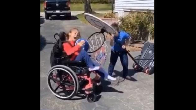Tomas helping Abby play basketball.(Youtube)