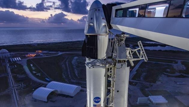 In a photo provided by SpaceX, SpaceX's Dragon crew capsule sits atop a Falcon 9 rocket Sunday morning, May 24, 2020, at Cape Canaveral, Florida. SpaceX will attempt to launch NASA astronauts Doug Hurley and Bob Behnken to the International Space Station on Wednesday — a first for a private company.(AP)