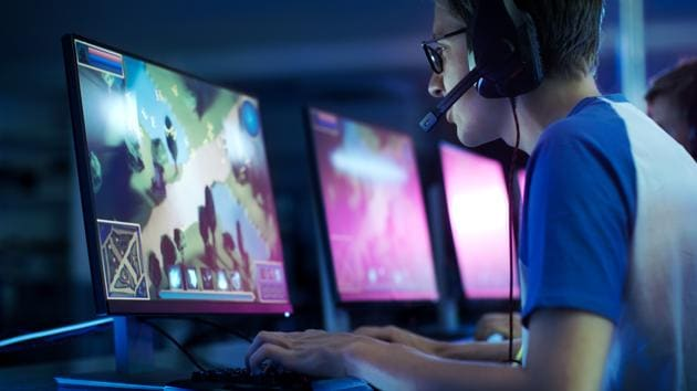 Team of Professional eSport Gamers Playing in Competitive MMORPG/ Strategy Video Game on a Cyber Games Tournament.(Getty Images/iStockphoto)