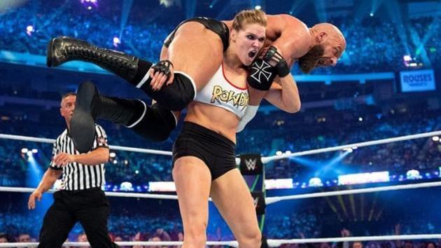 Ronda Rousey against Triple H.(WWE)