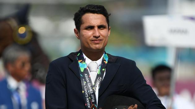 India's silver medallist Fouaad Mirza takes part in the awards ceremony for the eventing individual event at the equestrian competition at the 2018 Asian Games in Jakarta. (Photo by Arief Bagus / AFP)(AFP)
