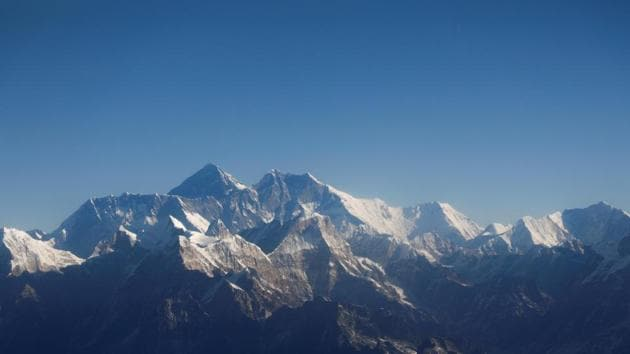 Mount Everest, the world highest peak, and other peaks of the Himalayan range are seen through an aircraft window during a mountain flight from Kathmandu, Nepal.(REUTERS/File Picture)