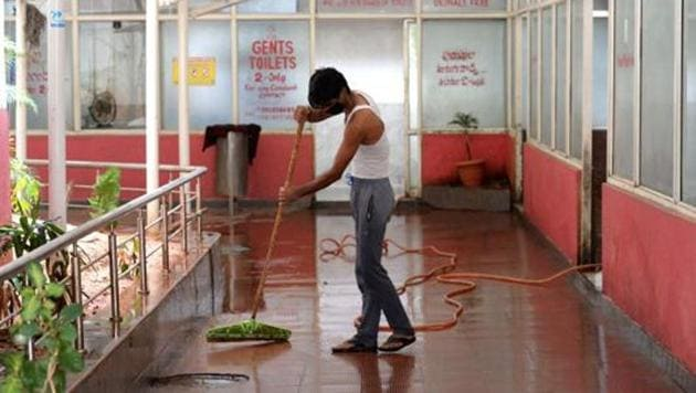 A worker cleans toilets at Jubilee Bus Station (JBS) as Telangana State Road Transport Corporation (TSRTC) resumed bus services after the government eased a nationwide lockdown imposed as a preventive measure against the COVID-19 coronavirus in Secunderabad on May 19, 2020/ representative.(AFP)