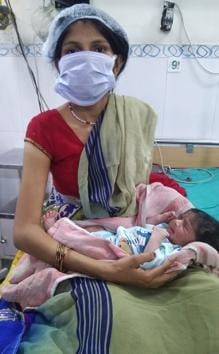 Garima, who was about to board a Shramik Special train to UP from Chandigarh, got labour pains and was rushed to civil hospital in Manimajra where she has delivered a baby boy.(SANT ARORA/HT)