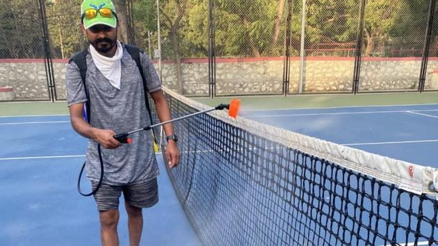 With tennis academies closed for the last two months, owners have begun cleaning and sanitising the courts.(HT PHOTO)