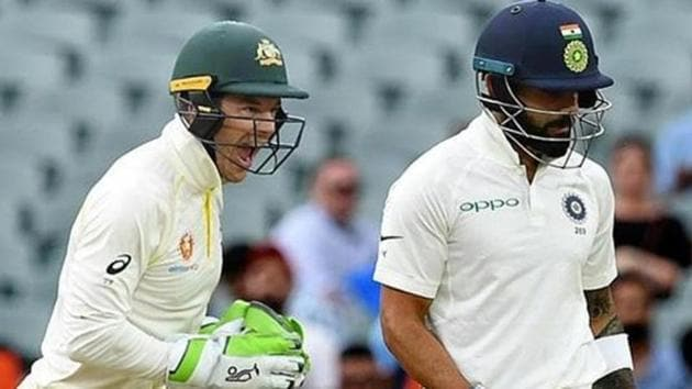 Tim Paine (L) celebrates as Virat Kohli leaves the field after being dismissed on day three of the first test match between Australia and India at the Adelaide Oval in Adelaide, Australia, December 8, 2018.(REUTERS)